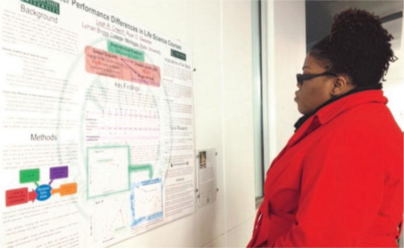 Student observes showcase poster